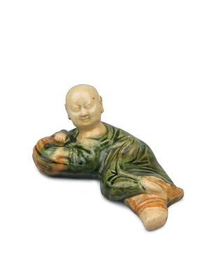 Sancai ceramic brush rest in the form of a recumbent boy