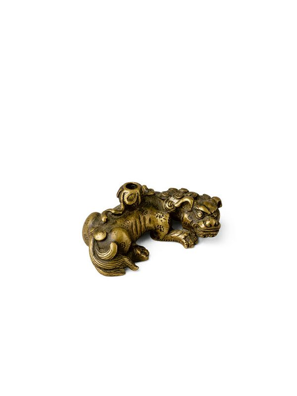 Gilt bronze paperweight in the form of a recumbent lion