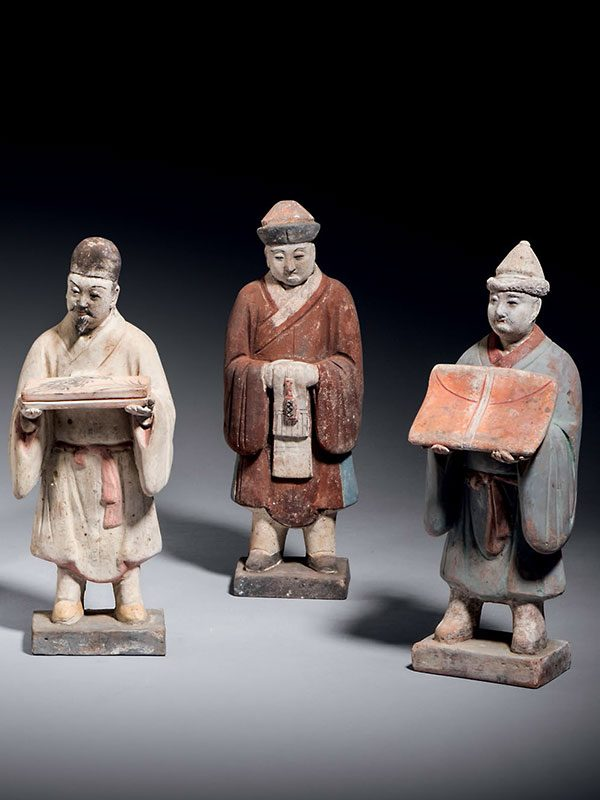 Pottery group of male figures