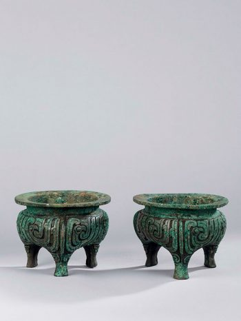 A pair of bronze ritual tripod vessels <em>li</em>