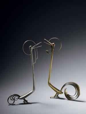 Two metal sculptures of birds, by Katou Sougen