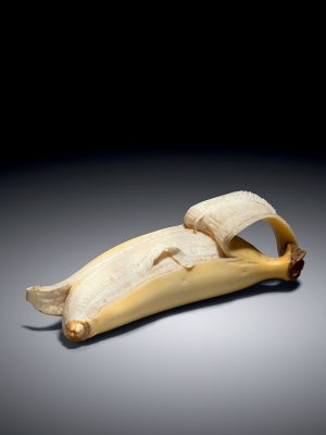 Ivory okimono of a half-peeled banana