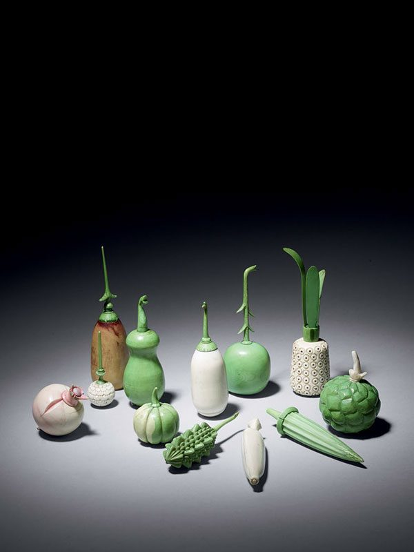 Group of ivory scent bottles in the shape of vegetables and fruits