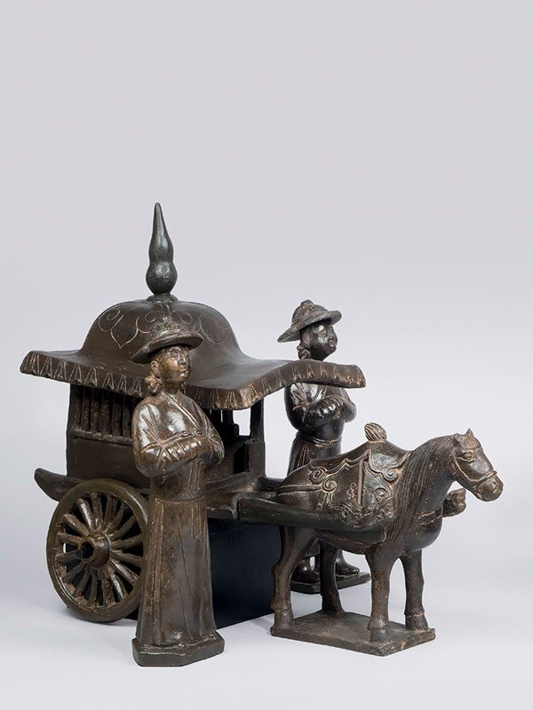 Group of black pottery horses, figures and a carriage