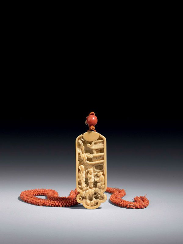 Ivory pendant with coral-bead necklace