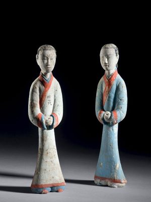 Two inscribed pottery figures of attendants