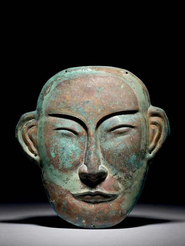 Copper funerary mask
