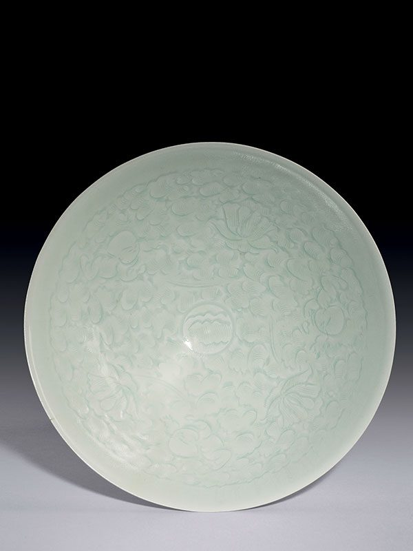 Qingbai porcelain bowl with incised decoration of three boys playing