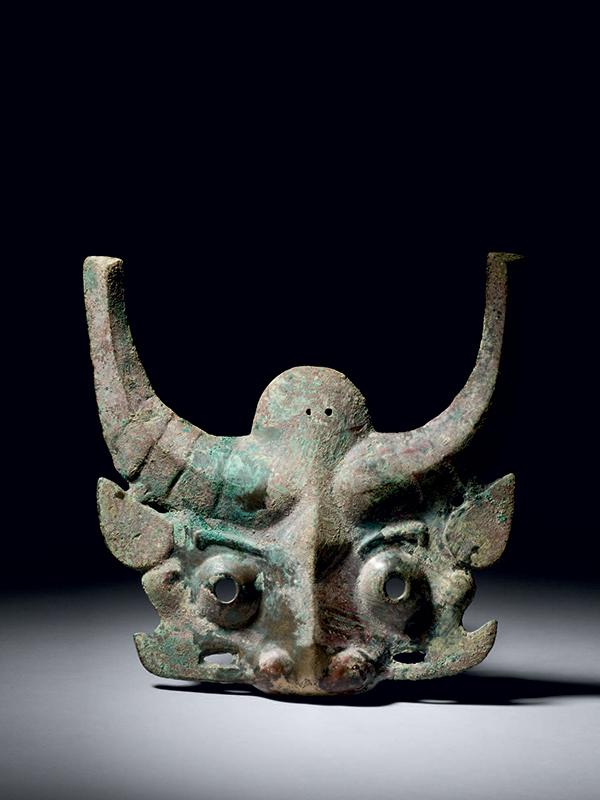 Bronze bovine mask