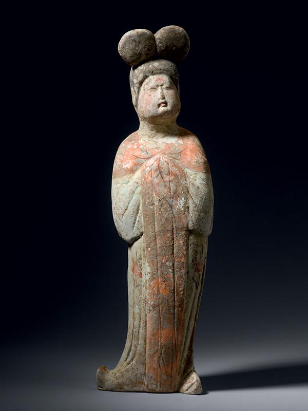 Pottery figure of a woman