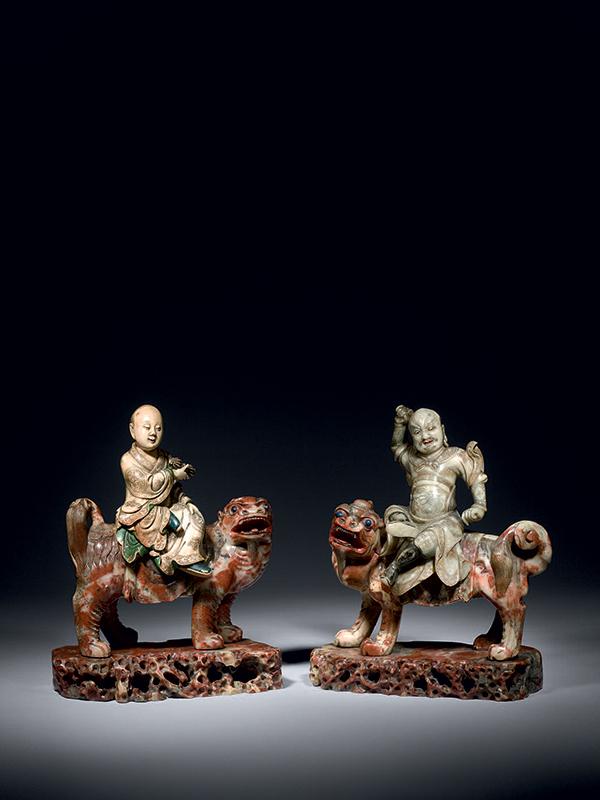 Two soapstone Buddhist groups