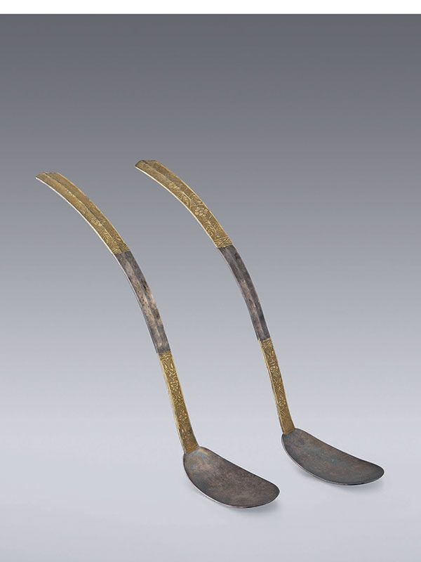A pair of silver and parcel-gilt spoons