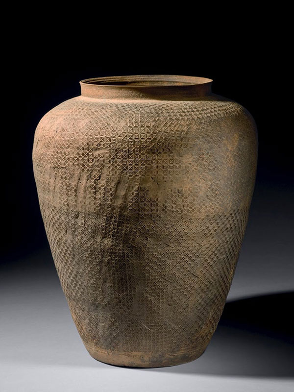 Pottery jar with impressed textile pattern