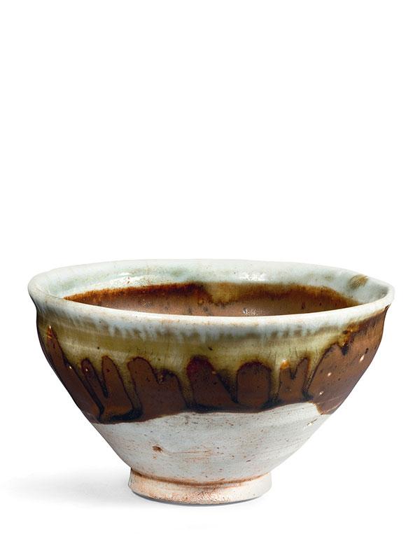Stoneware bowl with brown glaze and white rim