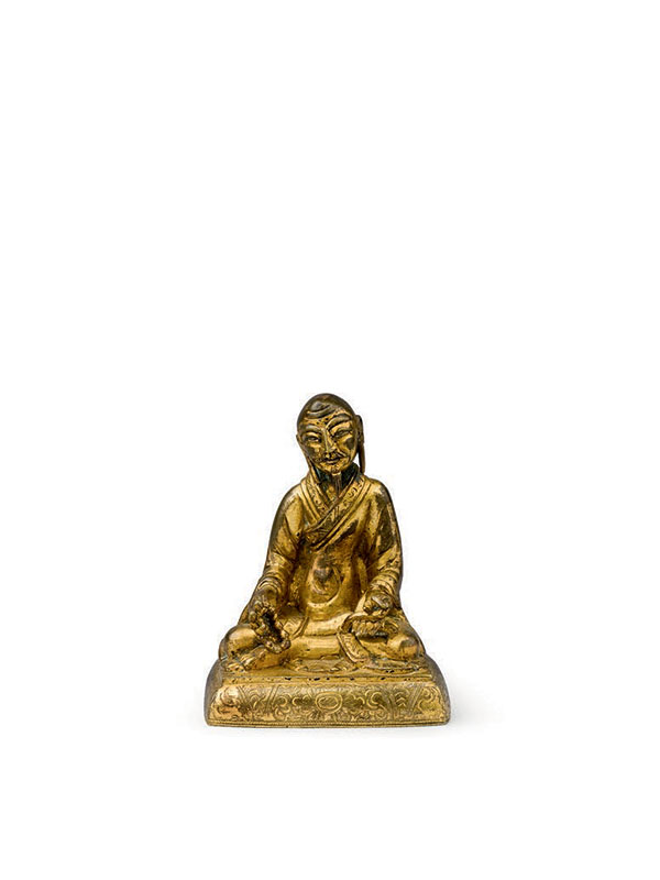 Gilt bronze miniature figure of a seated luohan