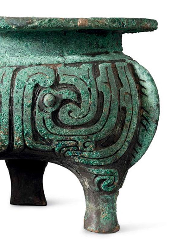 A pair of bronze ritual tripod vessels, li