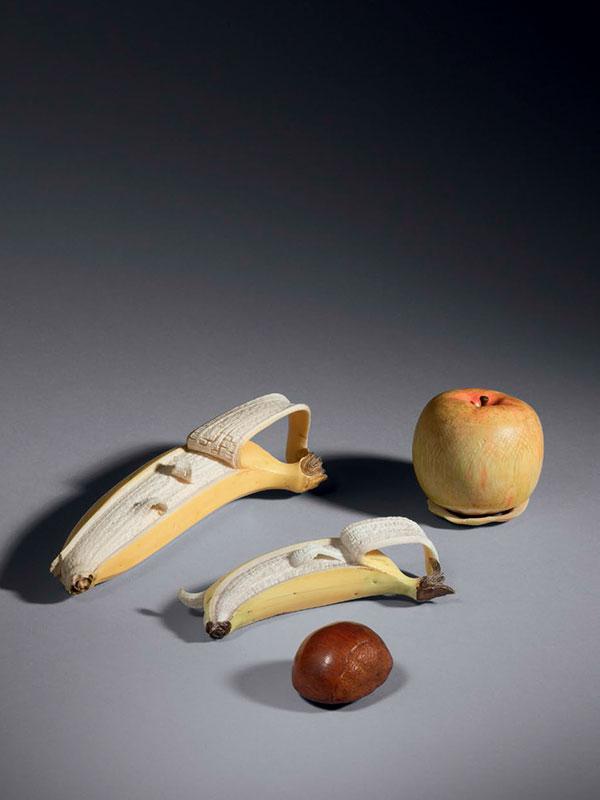 A group of ivory okimono of fruit