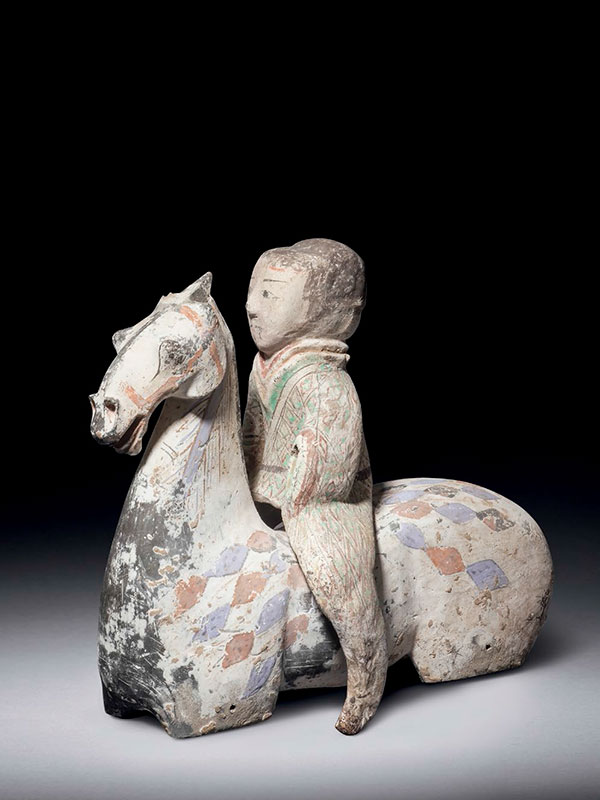 Two pottery horse torsos with riders