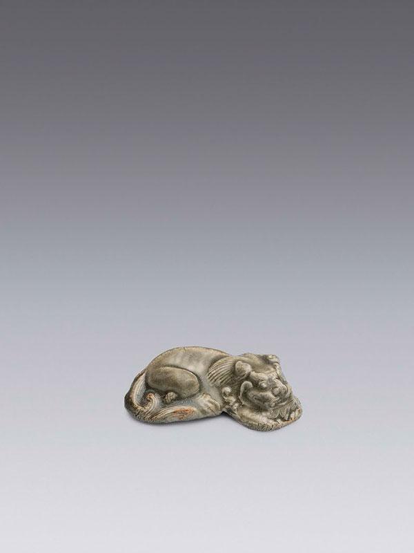 Yaozhou stoneware model of a recumbent lion