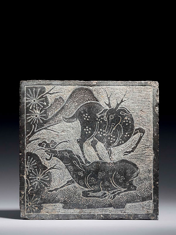 Stone panel carved with two deer