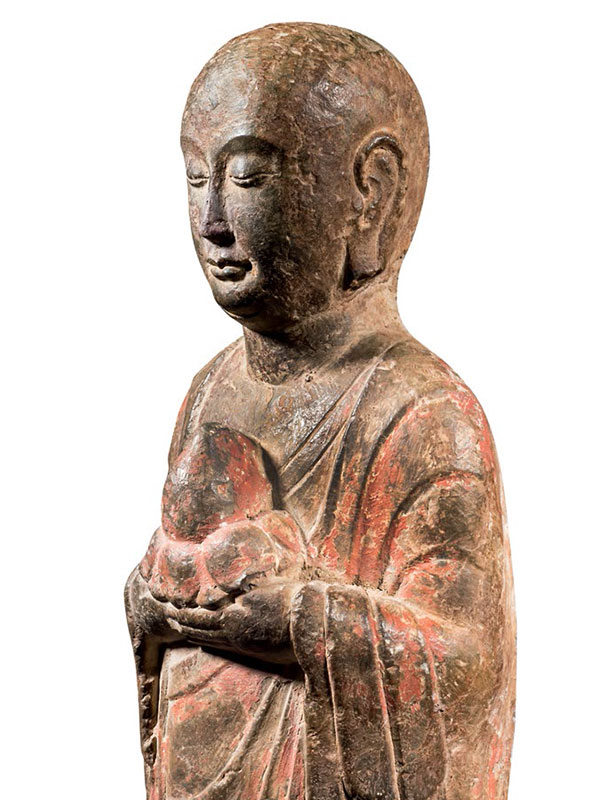 Two limestone sculptures of monks