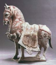 Fig1. Standing horse with bridle and blanketed saddle, Eastern Wei Period. Anthony M. Solomon collection