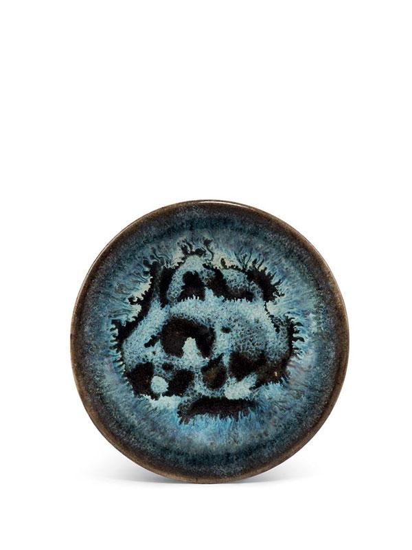 Black glazed stoneware saucer with milky-blue splashes