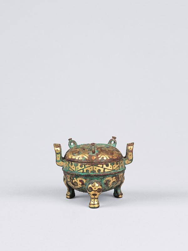 Gold inlaid miniature bronze tripod vessel, ding