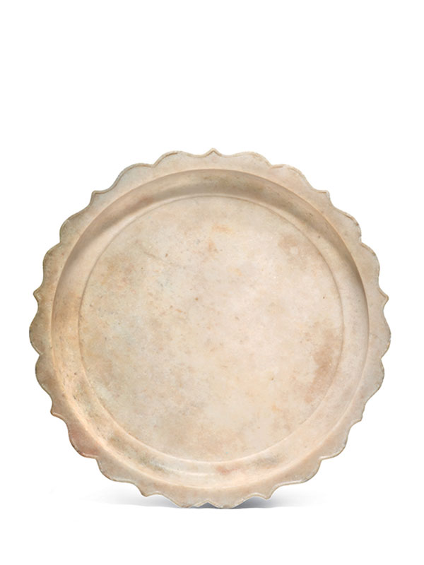 White marble dish with scalloped rim