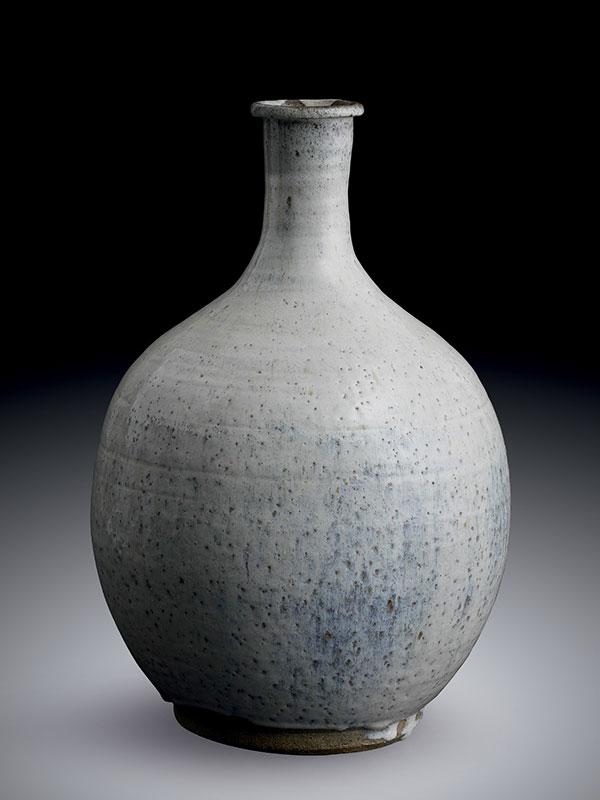 White glazed earthenware bottle vase