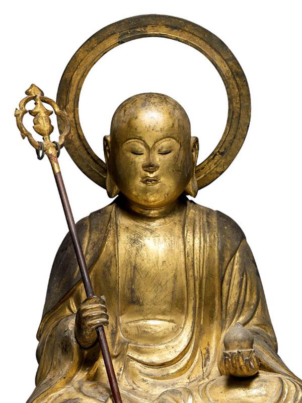 Wood sculpture of a seated Buddha Jizo Bosatsu