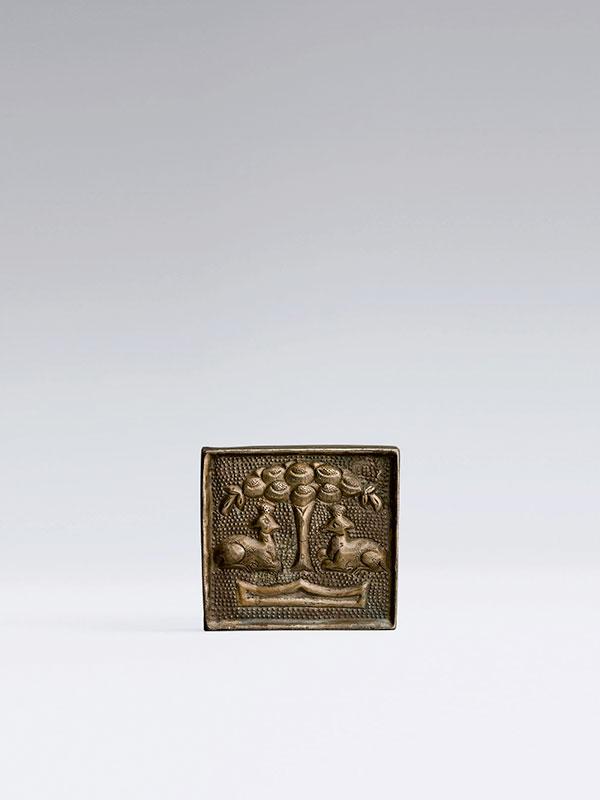 Silver belt plaque