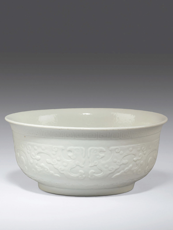 White porcelain bowl with stylized dragons