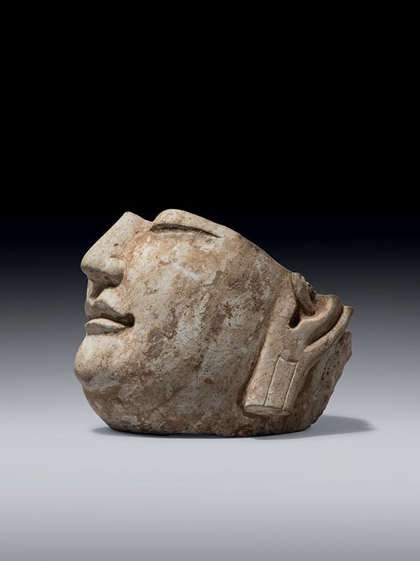 Fragmentary limestone head of Buddha