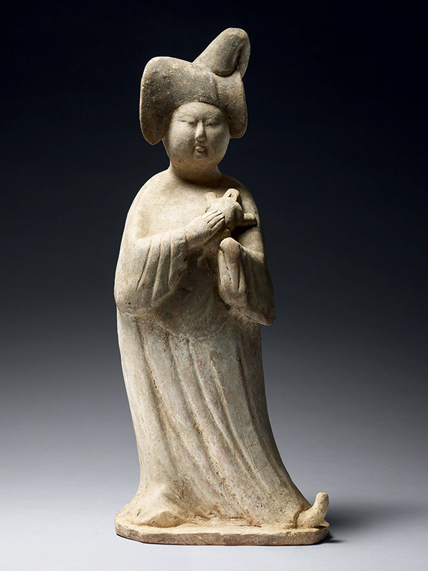Pottery figure of a court lady holding an animal
