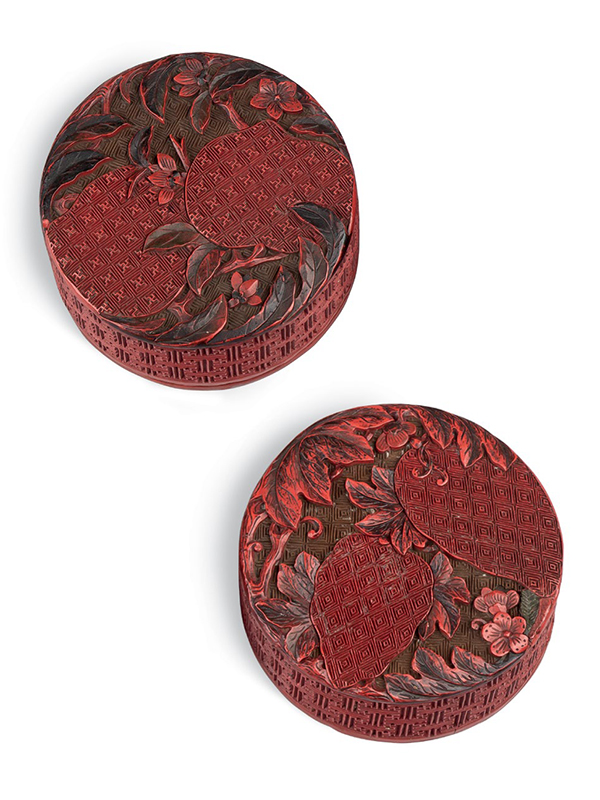 Pair of red lacquer circular boxes with fruits