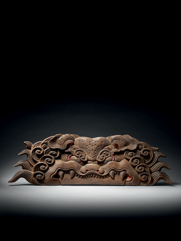 Architectural carving of a monster's mask