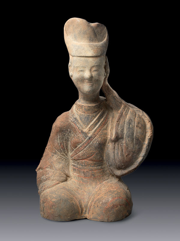 Pottery figure with hand on ear
