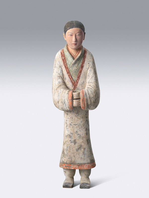 Pottery figure of a standing court attendant