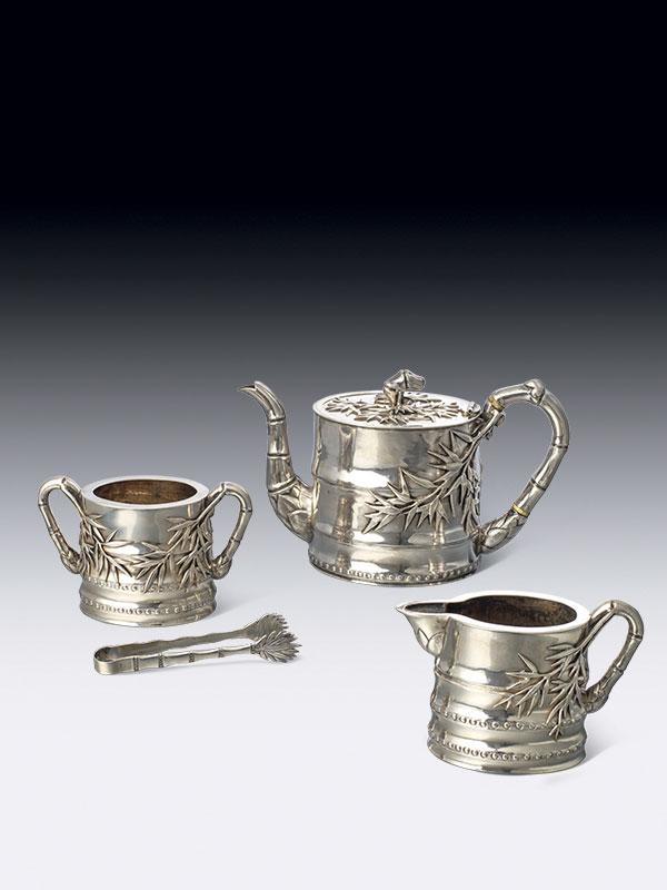 Three-piece silver tea set by Cumshing
