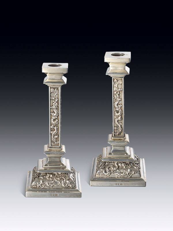 Pair of silver candlesticks by Wang Hing